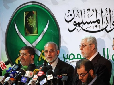 08e3530fb Egytian president Mohamed Morsi and the Supreme guide of the Muslim  brotherhood, Mohammed Badie.
